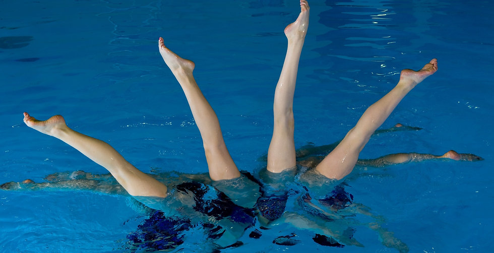 Synchronized swimmers with legs out of water_edited_edited.jpg