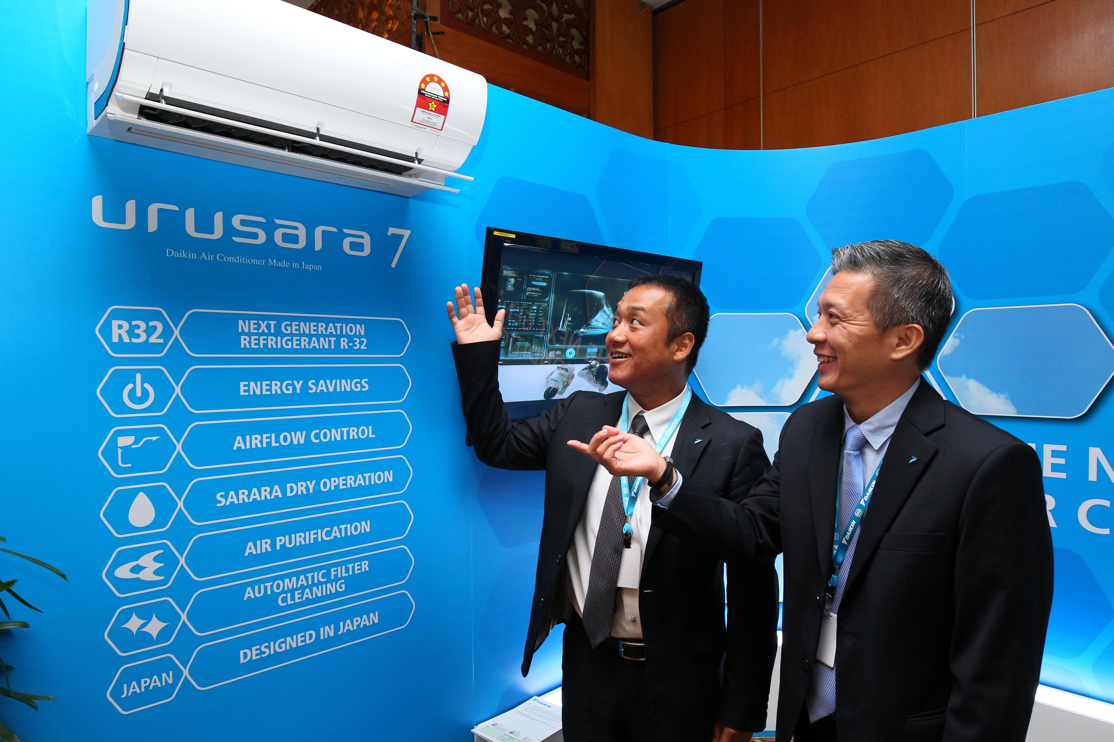 Mr Ryuta Hiramoto (left) and Mr Edwin Chai with the Urusara 7
