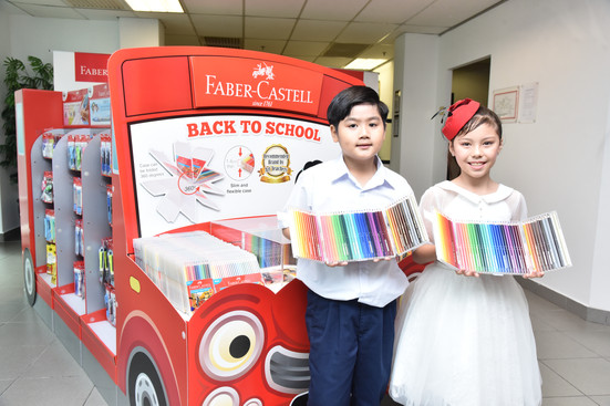 Models Posing with the Faber-Castell Back-to-School Bus.
