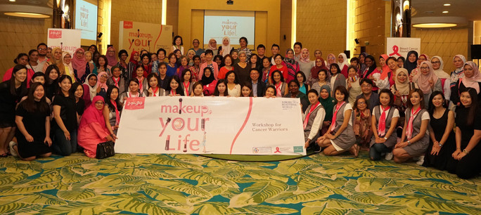 A Group Photo of Cancer Patients and Sur