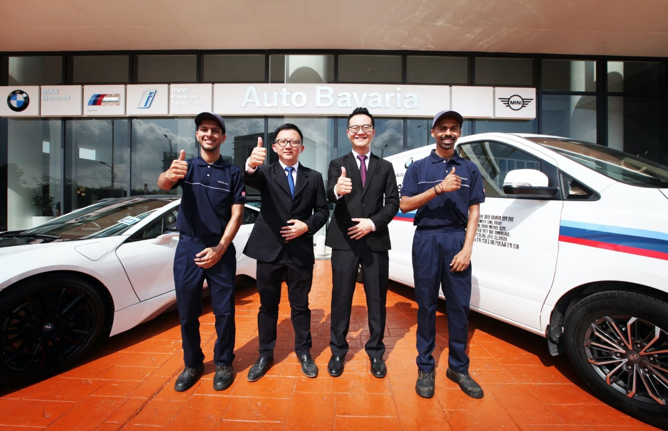Auto Bavaria's experienced and professional technicians with Desmond Cheah, Head of Aftersales Auto Bavaria and Boo Yi Ping, Supervisor Technician of Auto Bavaria.