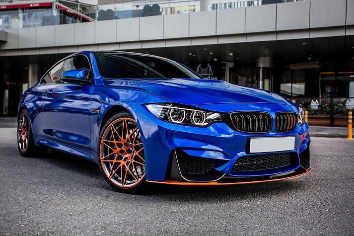 blue-sport-sedan-parked-yard.jpg