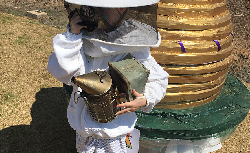 Little beekeeper with handmade skep sculpture by Judith Lomas