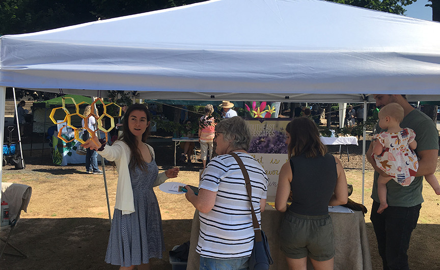 Southeast Beescapes' festival booth