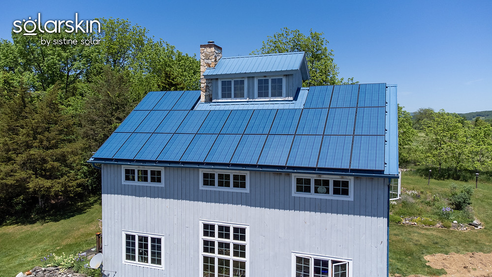 Solar panels on the roof blend in with the blue metal roof