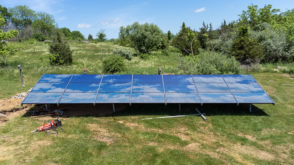 Ground mount design displays the sky and cumulus clouds to enhance the aesthetics of the solar panels