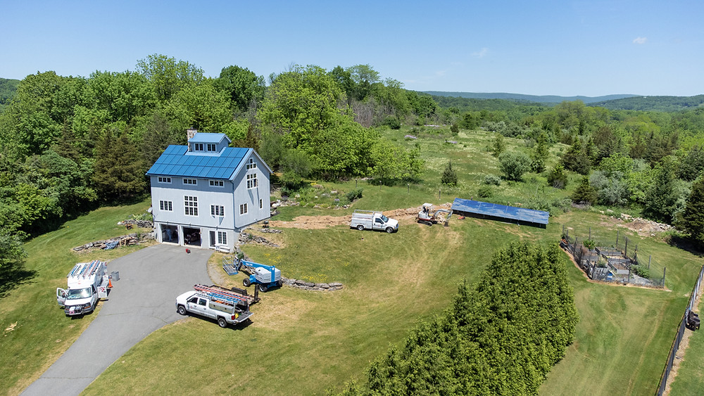 Beautiful solar panels on both the house and the ground mount
