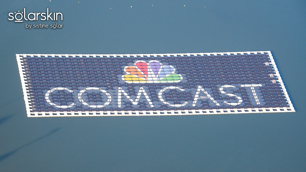 Comcast logo powered by SolarSkin on floating solar array