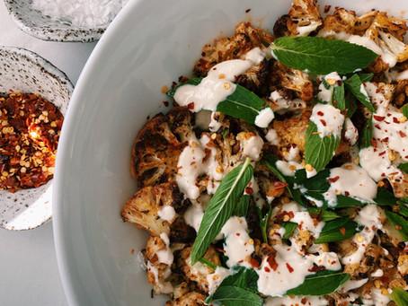 roasted cajun cauliflower salad with lemon tahini dressing