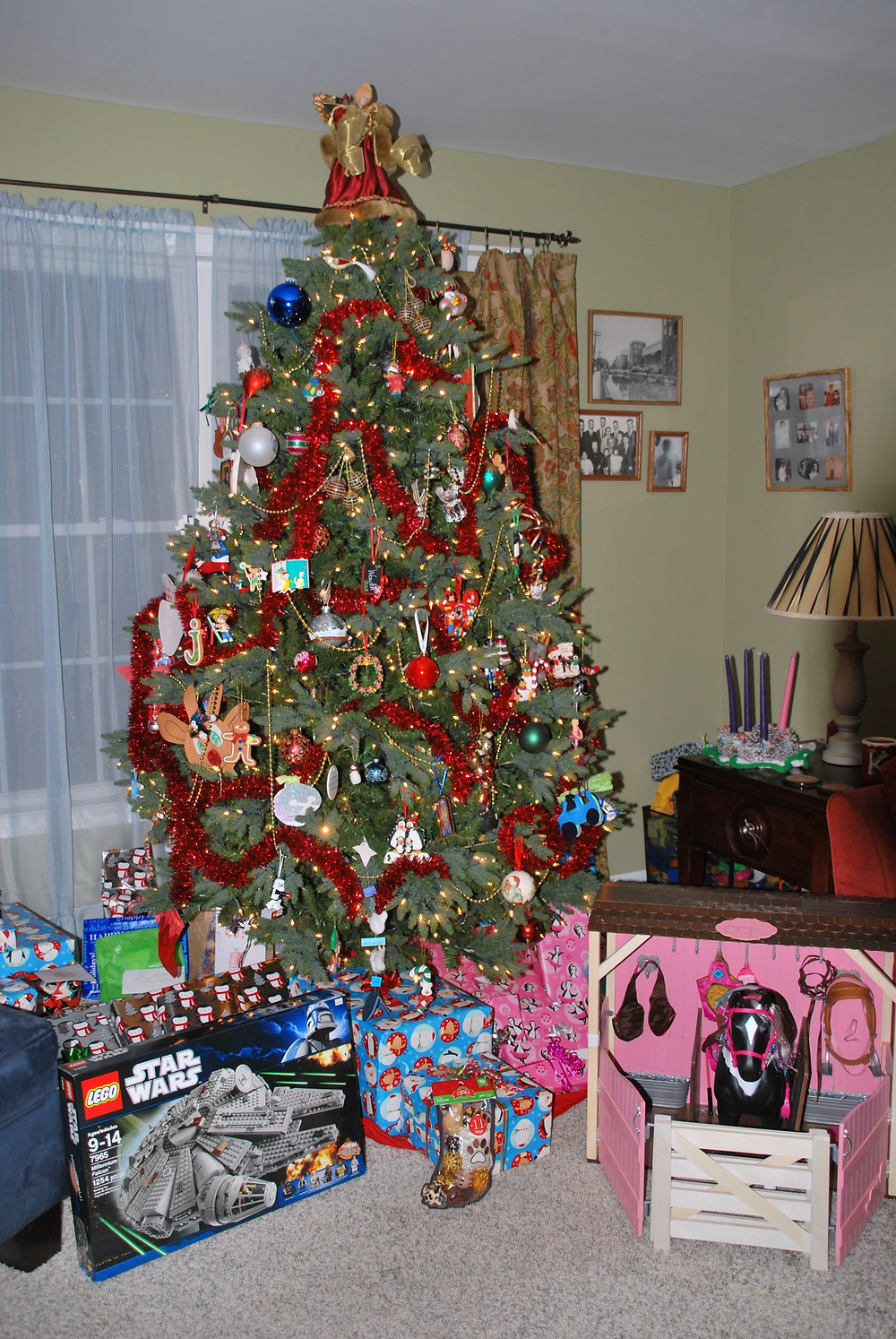 Christmas tree with unwrapped legos and American Girl stable and horse
