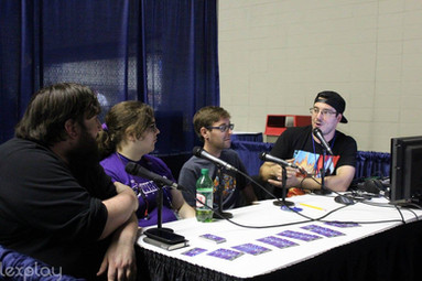 Steve and Natalie being interviewed by the Game Over Game On podcast at LexPlay