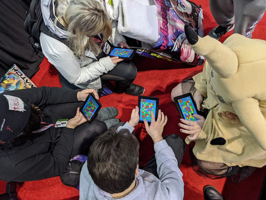 Circle of players, playing Collapsus at IndierMEGABOOTH 2020