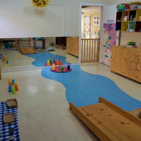 Aquarela Espaço Infantil: sala com espelho
