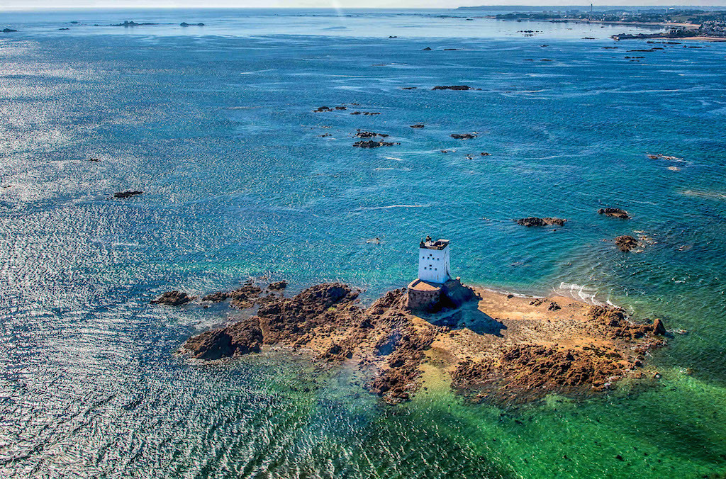 Seymour Tower, Royal Bay of Grouville. IchoTower can be seen top left and in the mid distance La Rocque Harbour, Robin Bay, Greve d'Azette and Havre de Pas (Photo - Colin Griffiths)