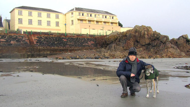 Author and Coady on beach 2016.  Same beach but shilnge and sand have gone, due to scour caused by reclamation at La Collette. (Photo - Elaine Cabeldu)