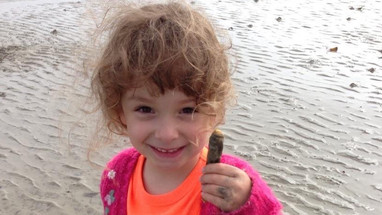 Rocky razorfishing 2013.  Author's granddaughter Rocky catching her first razor fish! Rather further along the coast (Photo - Mel Pardoe)