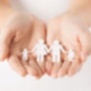 Hands surrounding family