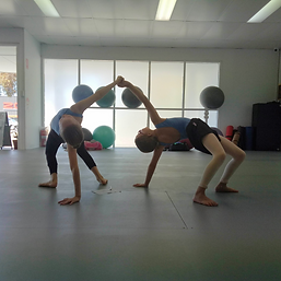 Contemporary dancers doing a backbend