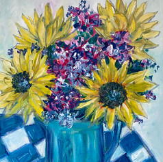 Sunflowers on checkered cloth