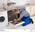 repairman-fixing-dishwasher-young-screwd