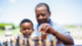 Man playing chess with grandson.jpg