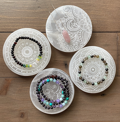 selenite plates - four with jewelry.png