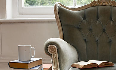Old chair surrounded by books