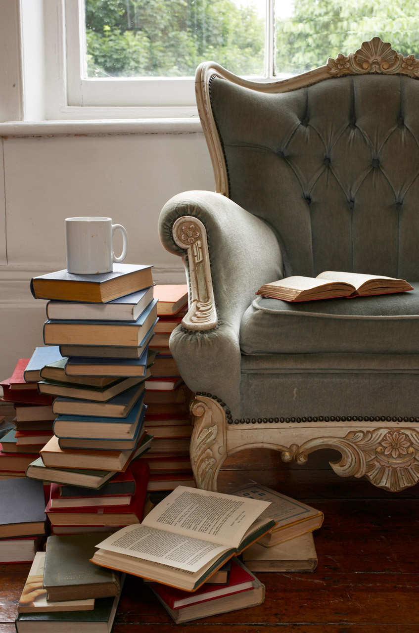 Chair with books and coffee mug