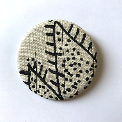 Badge tissu motif végétal