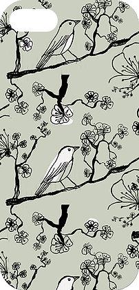 Coque oiseau sur sa branche