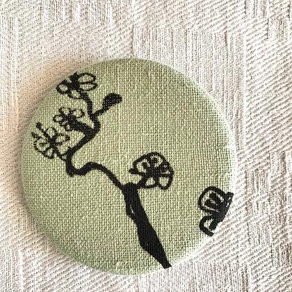 Badge tissu oiseau sur sa branche
