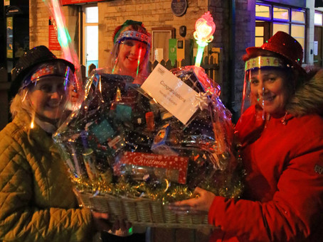 Finance Team Stages Festive 'Steam and Lights' Trains Christmas Hamper Raffles in Aid of SOS Appeal
