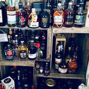 Just a snippet of our personal collection - it's now over 120 bottles and growing...