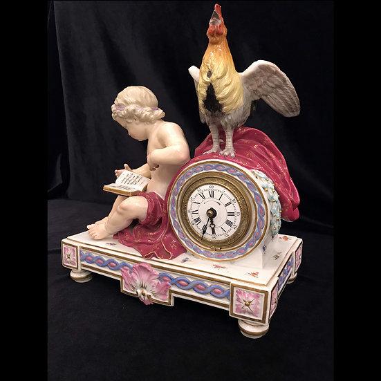 Часы «Петух и читающий путто»