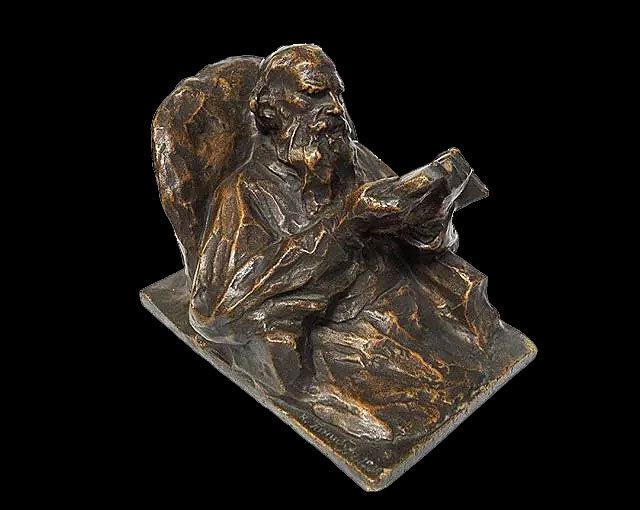 Л.Н.Толстой с книгой
