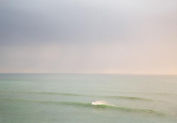 lone wave beach ocean