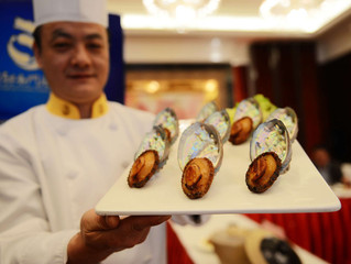 Sea Snails Fly 5,000 Miles to Grace Fine Dining Tables in China