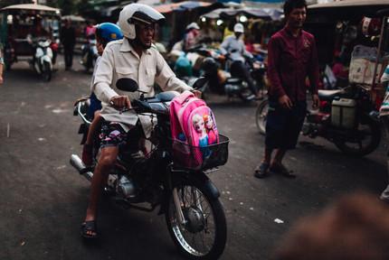 Street market Phnom Penh, Cambodia, early morning on way to school