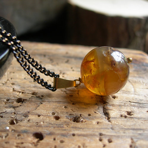 Amber in resin pendant