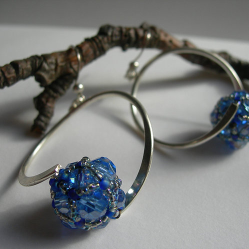 Curved earrings. Sapphire blue