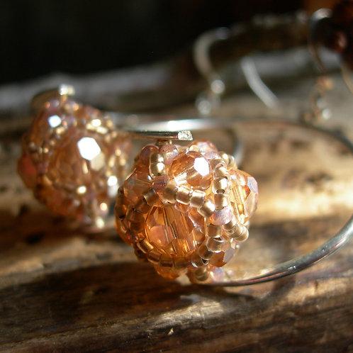 Curved earrings. Pale Orange