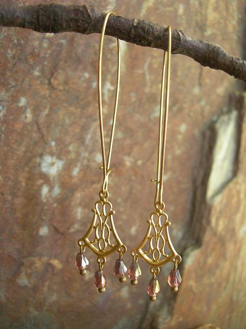 Ornate earrings. Light purple