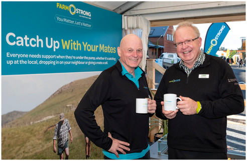 2 men with cups of tea at Fieldays by Kirk Vogel photographer