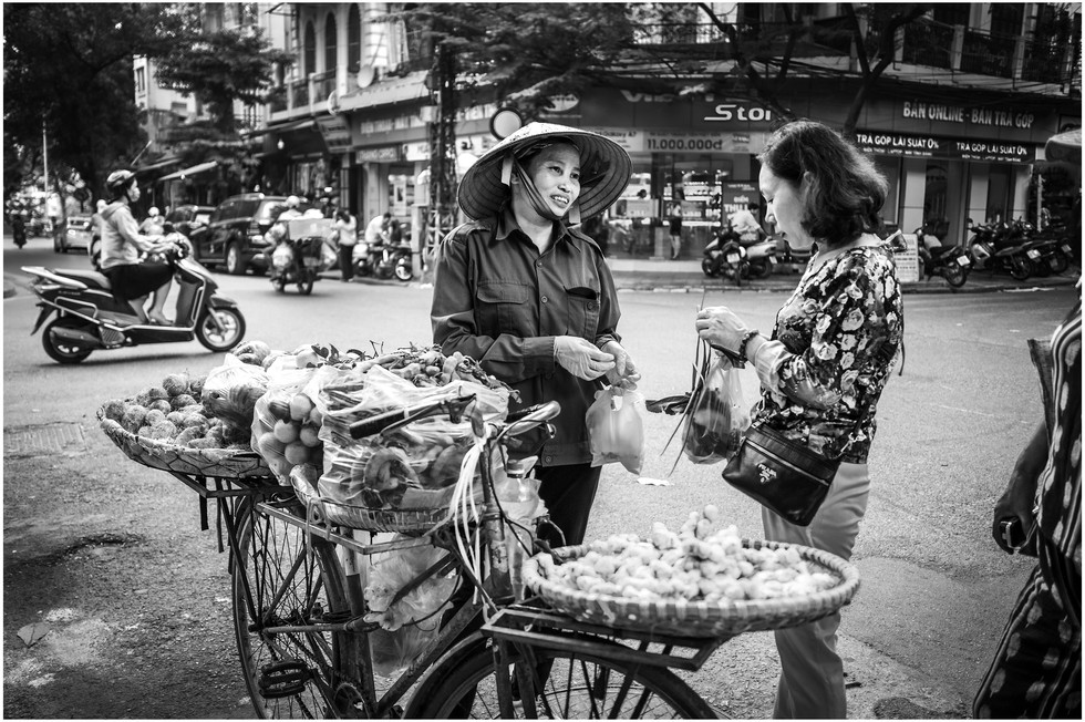 Vietnamese woman selling on the streets of Hanoi
