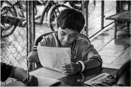 Cambodian boy studying