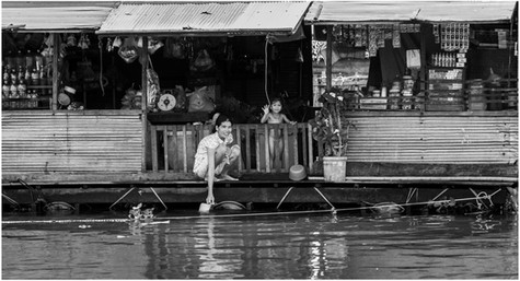 Shop keeper, floating village, Central Cambodia