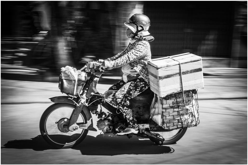 Vietnamese farmer on motorbike