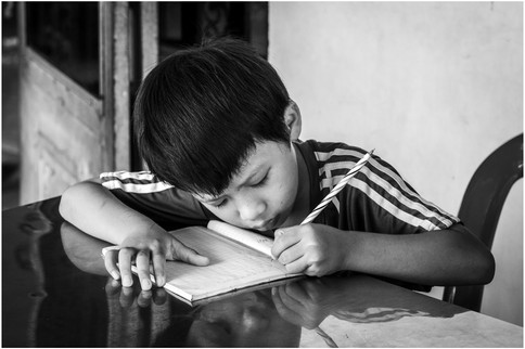 Child in Cambodian classroom