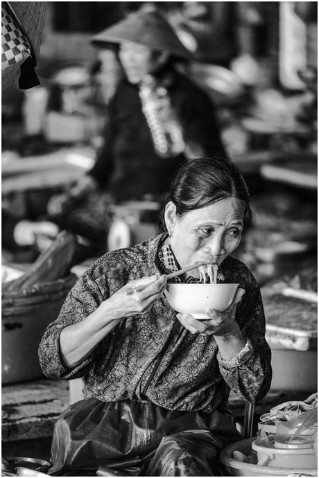 Vietnamese woman eating noodles