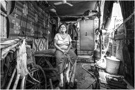 Cambodian woman in slum house